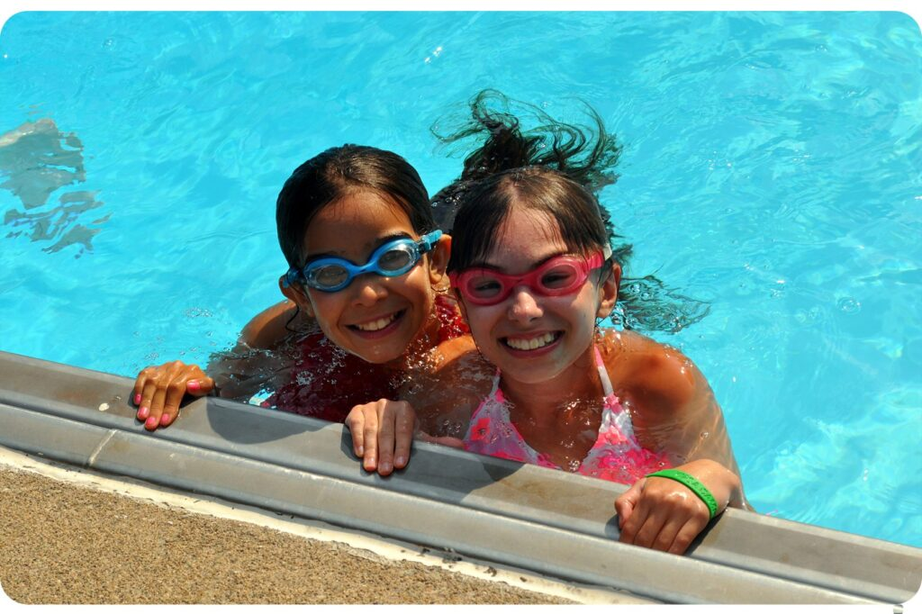 Smiling Day Campers at the Camp Mason Swimming Pool